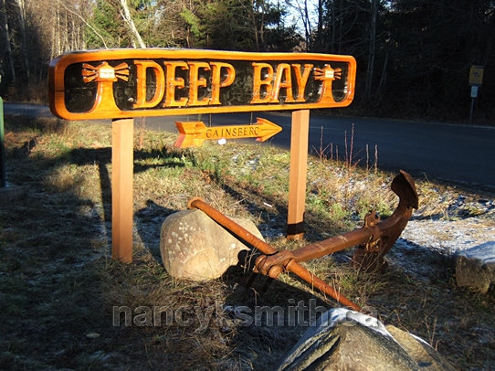 Photo of Deep Bay welcome sign