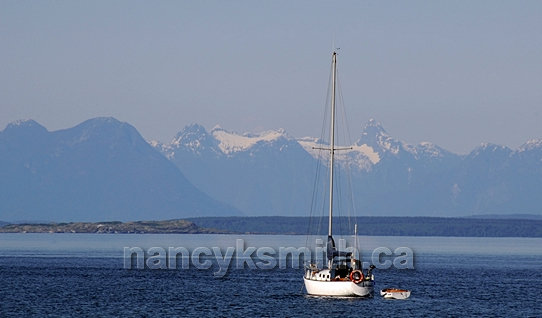 Photo of Sailboat Heading Out To Points Beyond