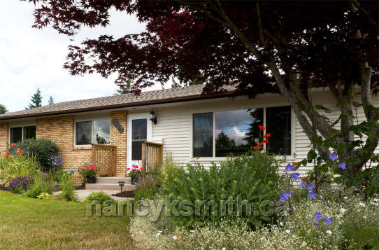 Photo of single family home on Tamarack Drive in Qualicum Beach, BC
